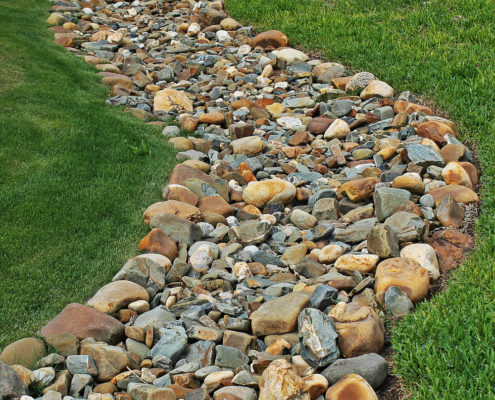 Add a french drain to prevent runoff
